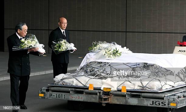 Japanese plant construction company JGC Co president Koichi Kawana offers a flower bunch on the coffin of their supreme advisor Tadanori Aratani who...