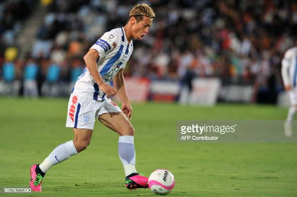 Japanese player Keisuke Honda of Pachuca runs with the ball during the Mexican Apertura tournament football match against Toluca at the Hidalgo...