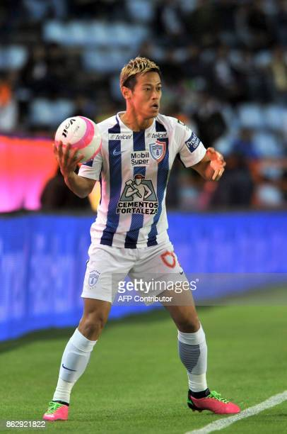 Japanese player Keisuke Honda of Pachuca throws in during the Mexican Apertura tournament football match against Toluca at the Hidalgo stadium on...