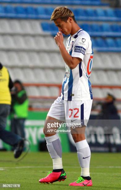 Japanese player Keisuke Honda of Pachuca walks the pitch during the Mexican Apertura tournament football match against Toluca at the Hidalgo stadium...