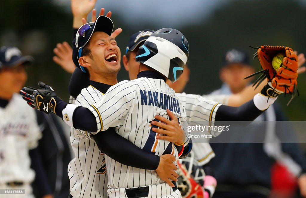 Japanese players celebrate a home run to team mate Kenji Nakamura of Japan during the pool B match between Japan and Canada at Tradstaff Sports Stadium on March 5, 2013 in Auckland, New Zealand.