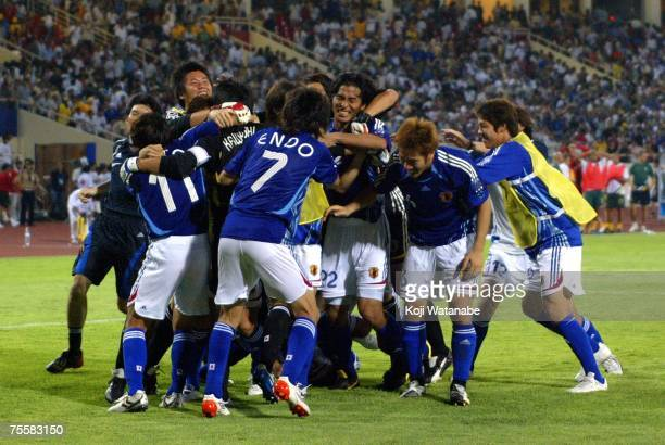 Japanese players celebrate their 43 victory on penalties at the close of the AFC Asian Cup 2007 Quarter Final match against the Australian Socceroos...