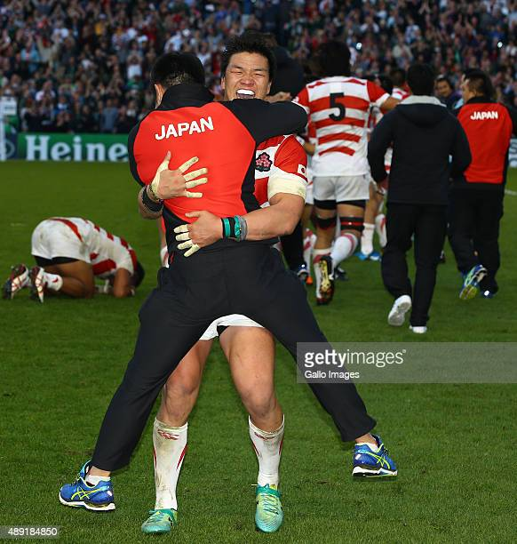 Japanese players celebrate their win during the Rugby World Cup 2015 Pool B match between South Africa and Japan at Brighton Community Centre on...