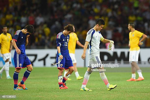 Japanese players leave the pitch after 04 defeat in the international friendly match between Japan and Brazil at the National Stadium on October 14...