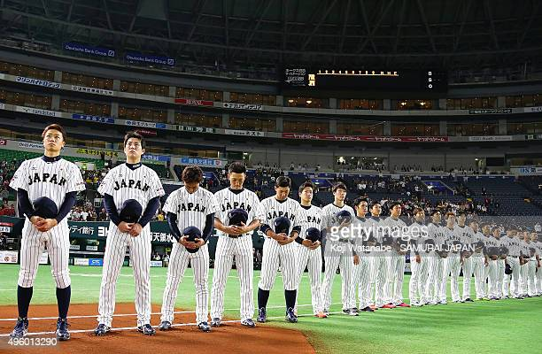 Japanese players line up for the national anthem prior to the sendoff friendly match for WBSC Premier 12 between Japan and Puerto Rico at the Fukuoka...