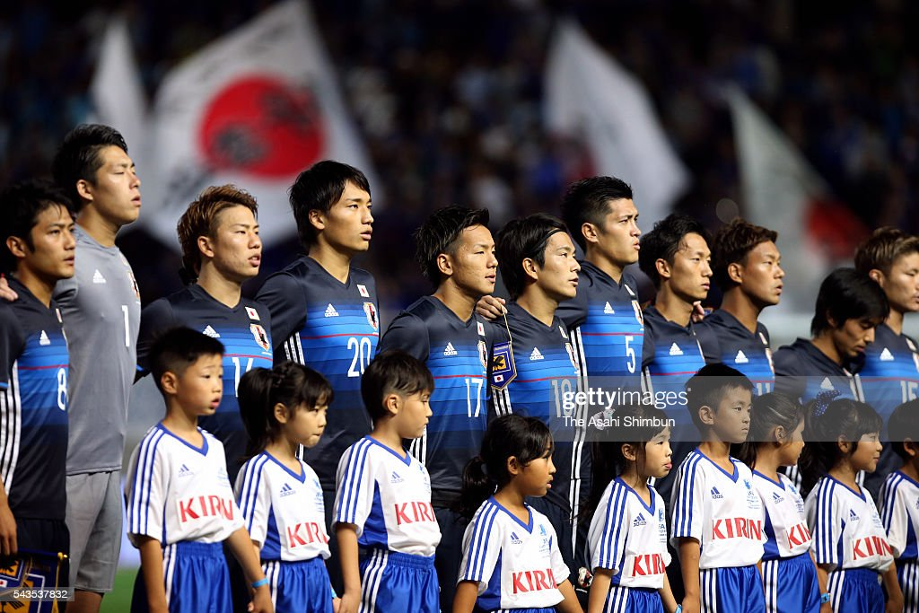 Japanese players line up for the national anthem prior to the U-23 international friendly match between Japan and South Africa at the Matsumotodaira Football Stadium on June 29, 2016 in Matsumoto, Nagano, Japan.