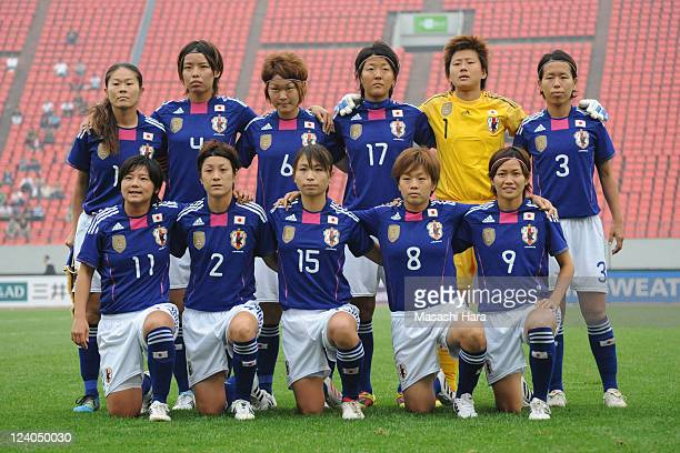 Japanese players pose for photographs prior to the London Olympic Women's Football Asian Qualifier match between North Korea and Japan at Shandong...