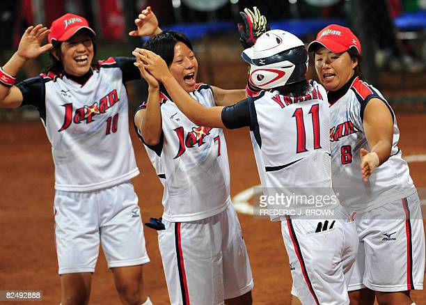 Japanese players Sachiko Ito Motoko Fujimoto and Megu Hirose celebrate with Eri Yamada after her fouth inning homerun off a pitch by Cat Osterman of...