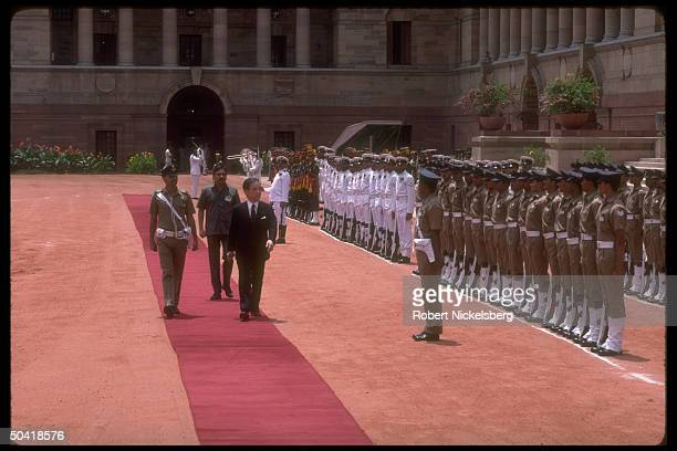 Japanese PM Toshiki Kaifu reviewing troops treading red carpet at pres palace arrival fete