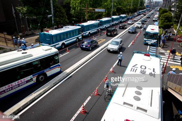 Japanese police buses are seen parked on the road during a counterprotest against quothate speechquot rally in Nakahara Kawasaki City Kanagawa...