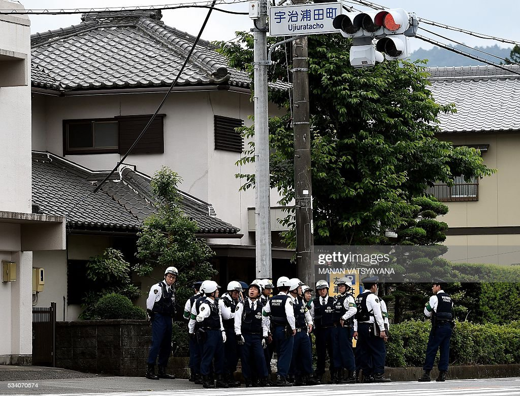 Japanese police stand guard at a road-intersection leading to the Inner Shrine of the Ise Grand Shrine in Ise-Shima, 300 kilometres southwest of Tokyo on May 25, 2016, ahead of the 2016 Ise-Shima G7 Summit. The annual event, which takes place on May 26-27, draws leaders from some of the world's richest nations, including US President Barack Obama and German Chancellor Angela Merkel. VATSYAYANA