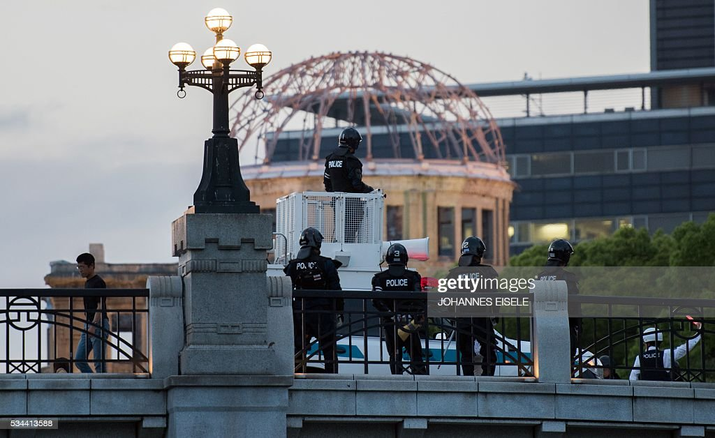 Japanese policemen stand guard next to the Hiroshima Peace Memorial park in Hiroshima on May 26, 2016. US President Barack Obama is set to become the first sitting US president to visit one of the bomb sites when he journeys on May 27, 2016 with Japanese Prime Minister Shinzo Abe to Hiroshima, hallowed ground to Japanese but, for more than 70 years, a no-go zone for 11 of his Oval Office predecessors. / AFP / JOHANNES