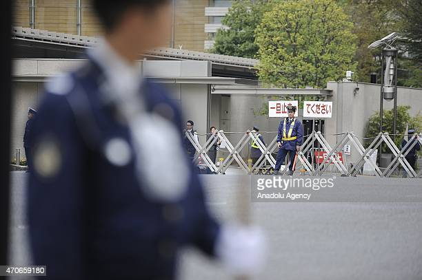 Japanese policemen take security measures around the Japan Prime Minister Shinzo Abe's office after an unidentified drone allegedly carrying small...