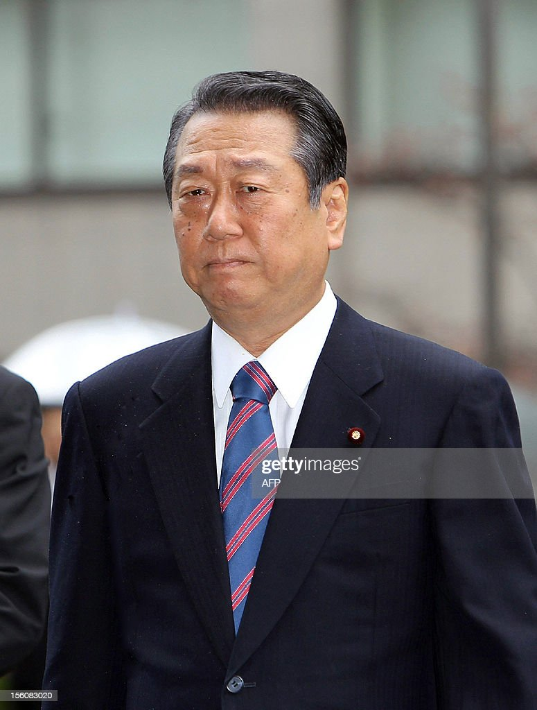Japanese political strongman Ichiro Ozawa enters the Tokyo High Court on November 12, 2012. Japan's appeal court acquitted Ozawa, former Democratic Party of Japan (DPJ) leader, in a political funding scandal, a verdict that could have an impact on politics ahead of looming elections.