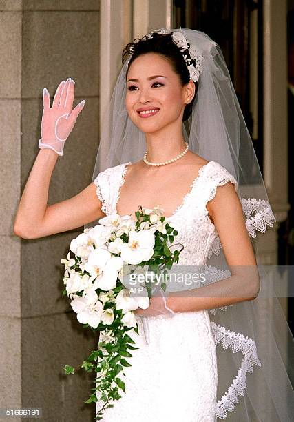 Japanese pop queen Seiko Matsuda waves after her wedding ceremony at a Tokyo hotel 25 May The babyfaced 36yearold singer Matsuda who divorced her...