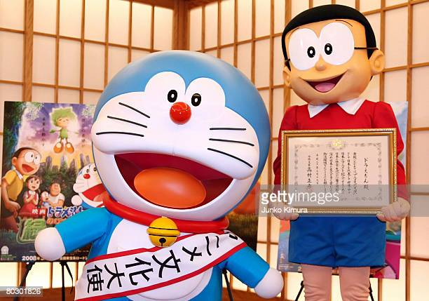 Japanese popular cartoon characters Doraemon and Nobitakun attend the Anime Ambassador inauguration ceremony at the Ministry of Foreign Affairs on...