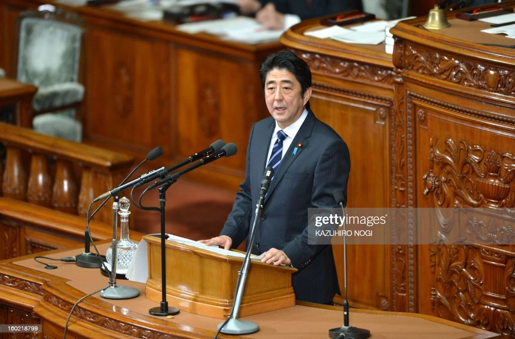 Japanese premier Shinzo Abe delivers his first policy speech in the lower house plenary session at the parliament in Tokyo on January 28, 2013. Abe pledged on January 28 he would not keep stimulus spending 'forever' in a policy speech ahead of a budget that will raise more in taxes than it does from borrowing. AFP PHOTO / KAZUHIRO NOGI