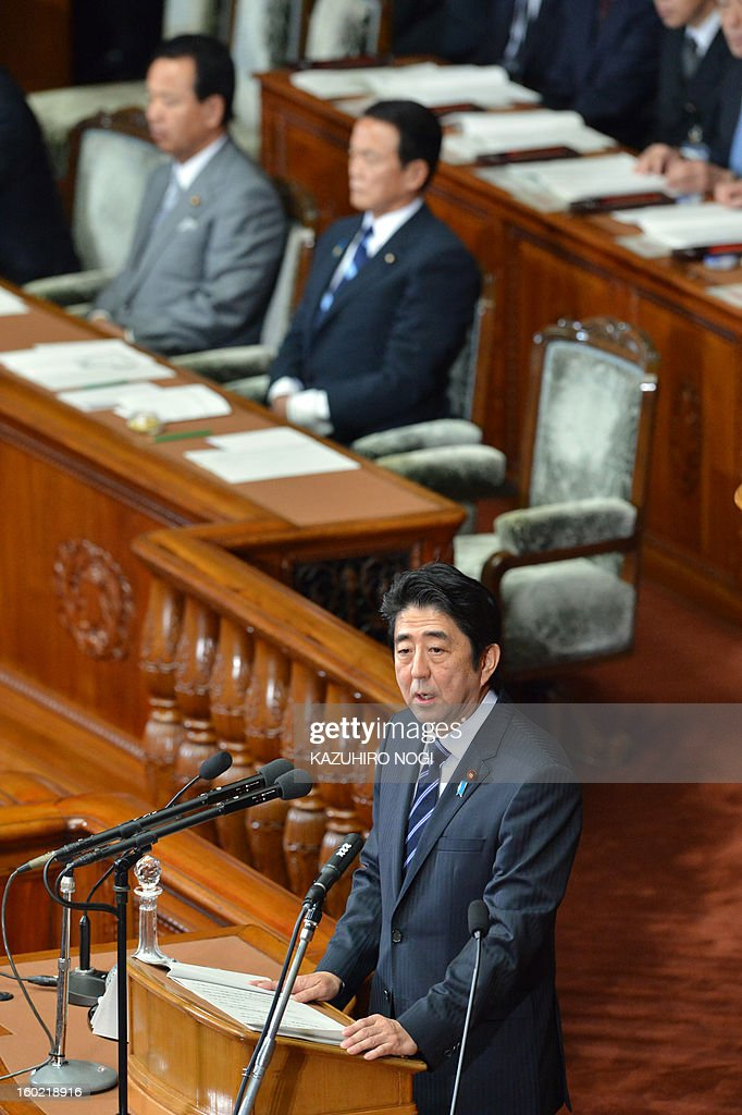 Japanese premier Shinzo Abe (bottom) delivers his first policy speech in the lower house plenary session at the parliament in Tokyo on January 28, 2013. Abe pledged on January 28 he would not keep stimulus spending 'forever' in a policy speech ahead of a budget that will raise more in taxes than it does from borrowing. AFP PHOTO / KAZUHIRO NOGI