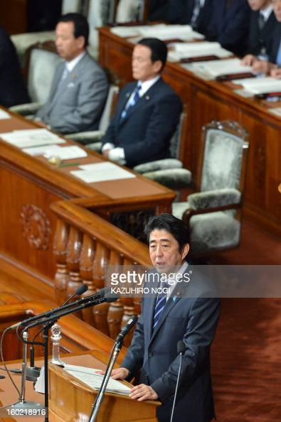 Japanese premier Shinzo Abe delivers his first policy speech in the lower house plenary session at the parliament in Tokyo on January 28 2013 Abe...