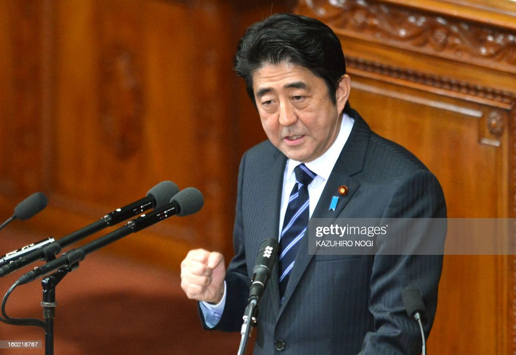 Japanese premier Shinzo Abe gestures as he delivers his first policy speech in the lower house plenary session at the parliament in Tokyo on January 28, 2013. Abe pledged on January 28 he would not keep stimulus spending 'forever' in a policy speech ahead of a budget that will raise more in taxes than it does from borrowing. AFP PHOTO / KAZUHIRO NOGI