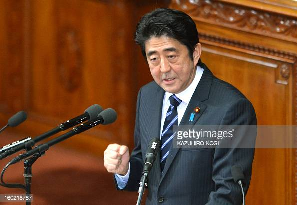 Japanese premier Shinzo Abe gestures as he delivers his first policy speech in the lower house plenary session at the parliament in Tokyo on January...
