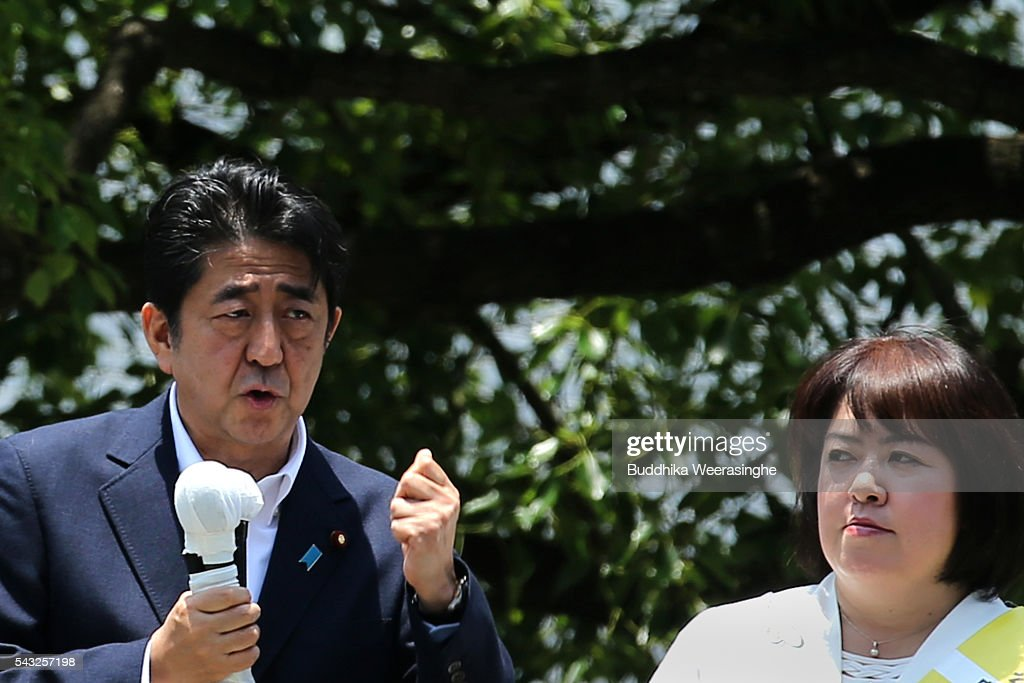 Japanese Prime Minister and president of the Liberal Democratic Party (LDP) <a gi-track='captionPersonalityLinkClicked' href=/galleries/search?phrase=Shinzo+Abe&family=editorial&specificpeople=559017 ng-click='$event.stopPropagation()'>Shinzo Abe</a> (L) speaks to voters alongside his ruling coalition junior partner New Komeito Party (NKP) election campaign for the upper house election as NKP candidate Take Itou listen on June 27, 2016 in Kobe, Japan. Japanese Prime Minister <a gi-track='captionPersonalityLinkClicked' href=/galleries/search?phrase=Shinzo+Abe&family=editorial&specificpeople=559017 ng-click='$event.stopPropagation()'>Shinzo Abe</a> joined the campaign to show support for a candidate from Komeito for the first time. The Komeito is a coalition partner of his Liberal Democratic Party.