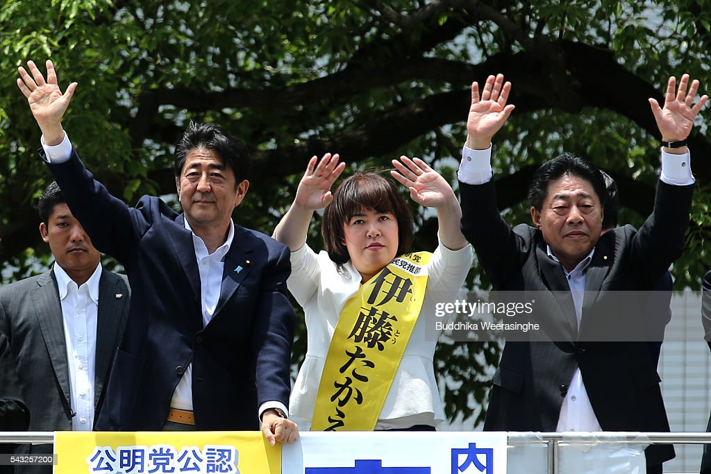 Japanese Prime Minister and president of the Liberal Democratic Party (LDP) <a gi-track='captionPersonalityLinkClicked' href=/galleries/search?phrase=Shinzo+Abe&family=editorial&specificpeople=559017 ng-click='$event.stopPropagation()'>Shinzo Abe</a> (L) and New Komeito Party (NKP) candidate Take Itou(C) wave to voters ruling coalition junior partner NKP election campaign for the upper house election on June 27, 2016 in Kobe, Japan. Japanese Prime Minister <a gi-track='captionPersonalityLinkClicked' href=/galleries/search?phrase=Shinzo+Abe&family=editorial&specificpeople=559017 ng-click='$event.stopPropagation()'>Shinzo Abe</a> joined the campaign to show support for a candidate from Komeito for the first time. The Komeito is a coalition partner of his Liberal Democratic Party.