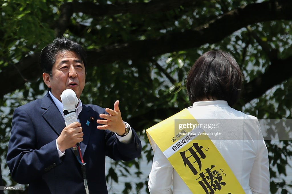 Japanese Prime Minister and president of the Liberal Democratic Party (LDP) <a gi-track='captionPersonalityLinkClicked' href=/galleries/search?phrase=Shinzo+Abe&family=editorial&specificpeople=559017 ng-click='$event.stopPropagation()'>Shinzo Abe</a> (L) speaks to voters alongside his ruling coalition junior partner New Komeito Party (NKP) election campaign for the upper house election as NKP candidate Take Itou on June 27, 2016 in Kobe, Japan. Japanese Prime Minister <a gi-track='captionPersonalityLinkClicked' href=/galleries/search?phrase=Shinzo+Abe&family=editorial&specificpeople=559017 ng-click='$event.stopPropagation()'>Shinzo Abe</a> joined the campaign to show support for a candidate from Komeito for the first time. The Komeito is a coalition partner of his Liberal Democratic Party.