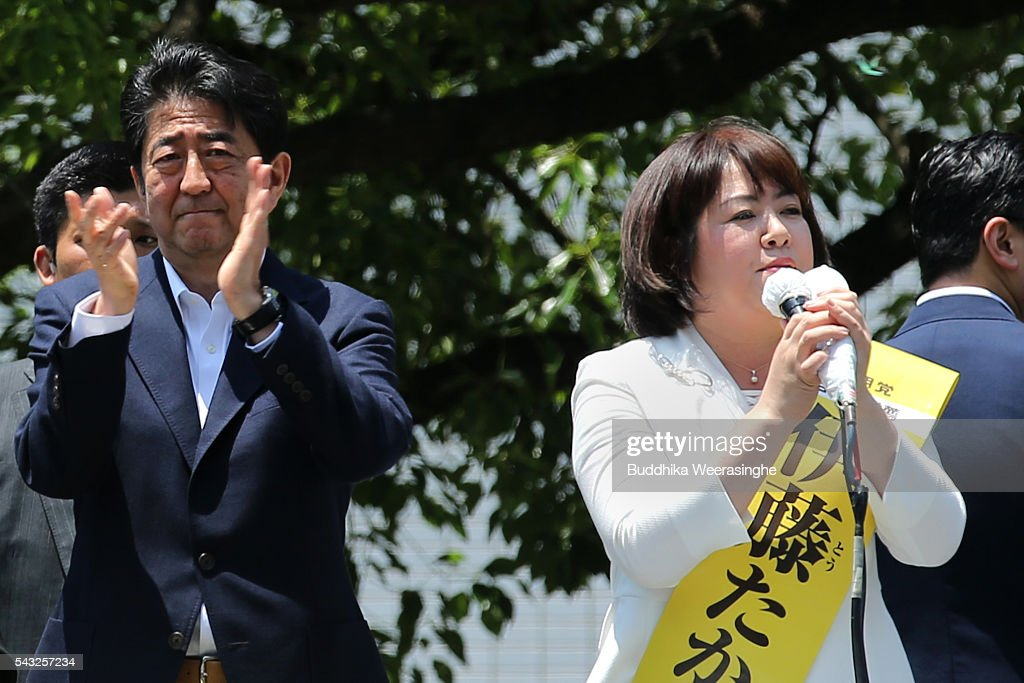 Japanese Prime Minister and president of the Liberal Democratic Party (LDP) <a gi-track='captionPersonalityLinkClicked' href=/galleries/search?phrase=Shinzo+Abe&family=editorial&specificpeople=559017 ng-click='$event.stopPropagation()'>Shinzo Abe</a> (L) cheers to alongside his ruling coalition junior partner New Komeito Party (NKP) election campaign for the upper house election as NKP candidate Take Itou speak on June 27, 2016 in Kobe, Japan. Japanese Prime Minister <a gi-track='captionPersonalityLinkClicked' href=/galleries/search?phrase=Shinzo+Abe&family=editorial&specificpeople=559017 ng-click='$event.stopPropagation()'>Shinzo Abe</a> joined the campaign to show support for a candidate from Komeito for the first time. The Komeito is a coalition partner of his Liberal Democratic Party.