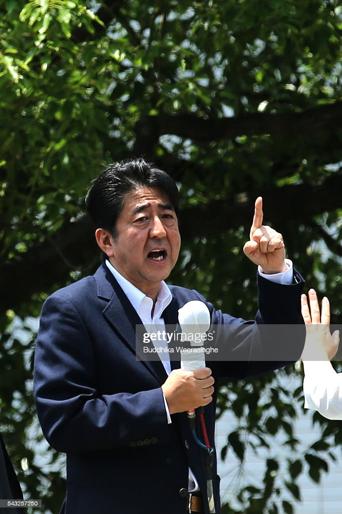 Japanese Prime Minister and president of the Liberal Democratic Party (LDP) <a gi-track='captionPersonalityLinkClicked' href=/galleries/search?phrase=Shinzo+Abe&family=editorial&specificpeople=559017 ng-click='$event.stopPropagation()'>Shinzo Abe</a> speaks to voters alongside his ruling coalition junior partner New Komeito Party (NKP) election campaign for the upper house election on June 27, 2016 in Kobe, Japan. Japanese Prime Minister <a gi-track='captionPersonalityLinkClicked' href=/galleries/search?phrase=Shinzo+Abe&family=editorial&specificpeople=559017 ng-click='$event.stopPropagation()'>Shinzo Abe</a> joined the campaign to show support for a candidate from Komeito for the first time. The Komeito is a coalition partner of his Liberal Democratic Party.