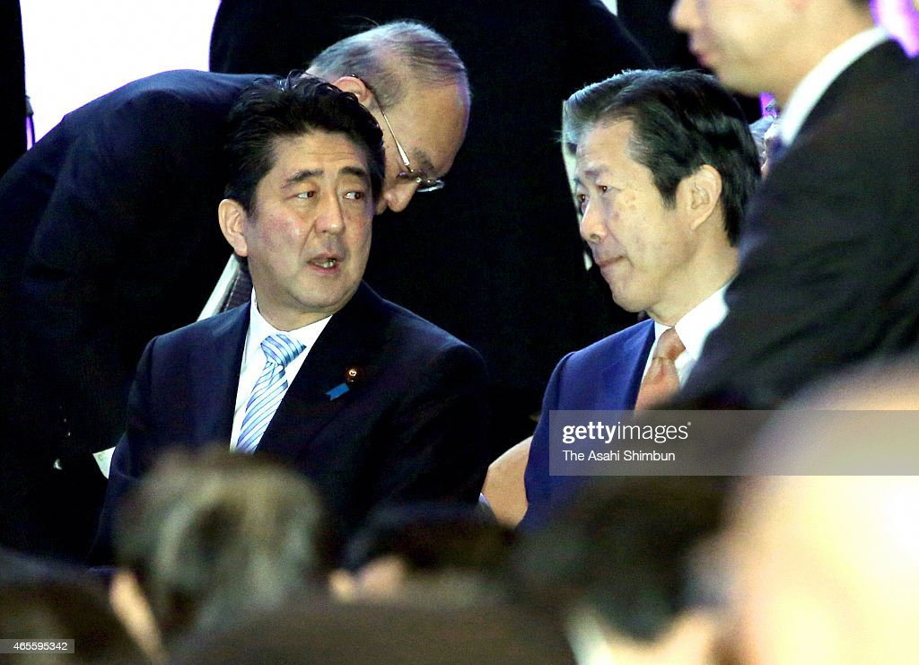Japanese Prime Minister and president of the ruling Liberal Democratic Party <a gi-track='captionPersonalityLinkClicked' href=/galleries/search?phrase=Shinzo+Abe&family=editorial&specificpeople=559017 ng-click='$event.stopPropagation()'>Shinzo Abe</a> (L) and junior coalition Komeito leader <a gi-track='captionPersonalityLinkClicked' href=/galleries/search?phrase=Natsuo+Yamaguchi&family=editorial&specificpeople=5718603 ng-click='$event.stopPropagation()'>Natsuo Yamaguchi</a> talk during the annual convention on March 8, 2015 in Tokyo, Japan.