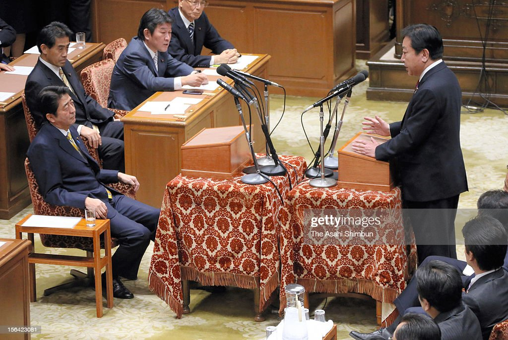 Japanese Prime Minister and ruling Democratic Party of Japan leader <a gi-track='captionPersonalityLinkClicked' href=/galleries/search?phrase=Yoshihiko+Noda&family=editorial&specificpeople=6441440 ng-click='$event.stopPropagation()'>Yoshihiko Noda</a> speaks while opposition Liberal Democratic Party leader <a gi-track='captionPersonalityLinkClicked' href=/galleries/search?phrase=Shinzo+Abe&family=editorial&specificpeople=559017 ng-click='$event.stopPropagation()'>Shinzo Abe</a> listens during their one on one debate at Diet building on November 14, 2012 in Tokyo, Japan. PM Noda will dissolve the lower house on November 16 and the general election will be on December 16.