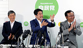 Japanese Prime Minister and ruling Liberal Demcratic Party President Shinzo Abe celebrates with the LDP vice president Masahiko Komura and secretary...