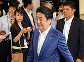 Japanese Prime Minister and ruling Liberal Demcratic Party President Shinzo Abe is seen on arrival at the LDP headqharters on July 10 2016 in Tokyo...