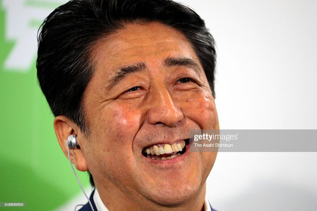 Japanese Prime Minister and ruling Liberal Demcratic Party President Shinzo Abe smiles during a press conference at the LDP headqharters on July 10, 2016 in Tokyo, Japan. Exit polls conducted on July 10 in a crucial Upper House election show the four parties that favor constitutional revision approaching the two-thirds threshold needed in that chamber to initiate an amendment. As voters went to the polls, the focus was on whether the four would win enough seats to reach the two-thirds majority in the 242-seat chamber needed for approval before an amendment could be put to a national referendum.