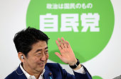 Japanese Prime Minister and ruling Liberal Demcratic Party President Shinzo Abe waves during a press conference at the LDP headqharters on July 10...