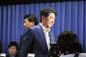 Japanese Prime Minister and ruling Liberal Demcratic Party President Shinzo Abe leaves after a press conference at the LDP headqharters on July 10...