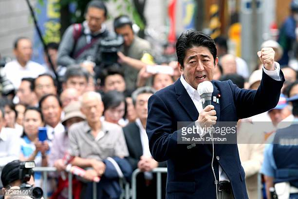 Japanese Prime Minister and ruling Liberal Democratic Party president Shinzo Abe makes a street speech calling for support at upcoming election on...
