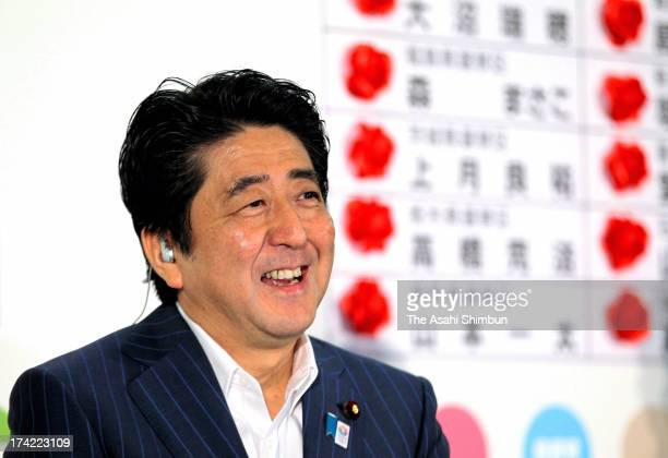 Japanese Prime Minister and ruling Liberal Democratic Party president Shinzo Abe speaks during a press conference at the LDP headquarters on July 21...