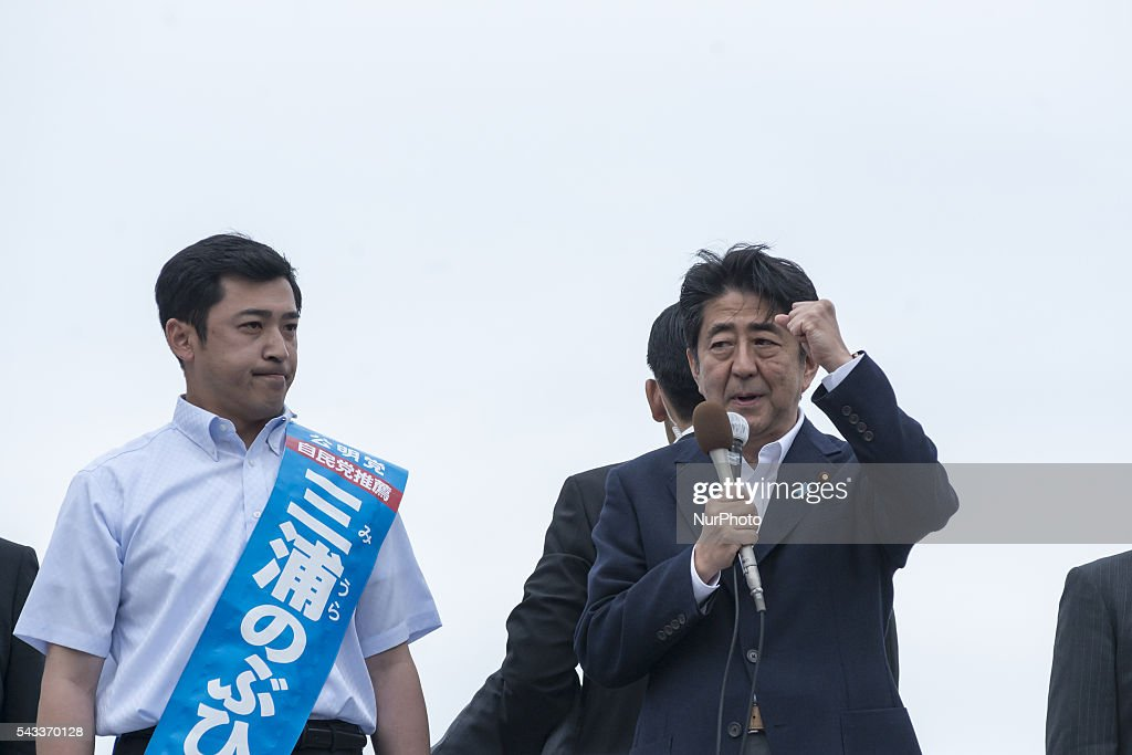 Japanese Prime Minister and ruling Liberal Democratic Party (LDP) president <a gi-track='captionPersonalityLinkClicked' href=/galleries/search?phrase=Shinzo+Abe&family=editorial&specificpeople=559017 ng-click='$event.stopPropagation()'>Shinzo Abe</a> delivers a campaign speech for his partys candidate Nobuhiro Miura during the Upper House election campaign in Yokohama in Kanagawa prefecture, June 27, 2016 Japan.