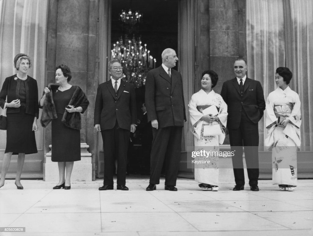 Japanese Prime Minister Hayato Ikeda (1899 - 1965) after visiting French President Charles de Gaulle at the Élysée Palace in Paris, France, November 1962. From left to right, Mrs Pompidou, Mrs De Gaulle, Ikeda, General de Gaulle, Mrs Ikeda, French Prime Minister Georges Pompidou and Ikeda's daughter.