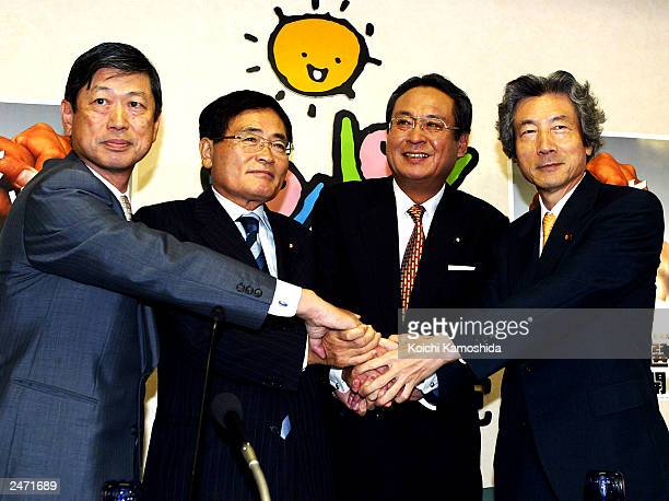 Japanese Prime Minister Junichio Koizumi shakes hands with former Foreign Minister Masahiko Komura former Policy Chief Shizuka Kamei and former...