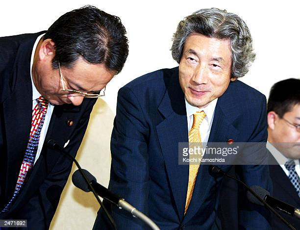 Japanese Prime Minister Junichio Koizumi speaks during a meeting at the Liberal Democratic Party headquarters September 8 2003 in Tokyo Koizumi is...
