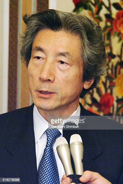 Japanese Prime Minister Junichior Koizumi talks to media reporters after the new South Korean President inauguration ceremony on February 25 2003 in...