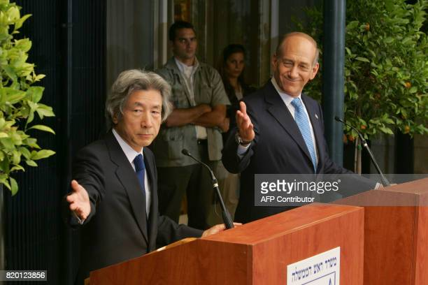 Japanese Prime Minister Junichiro Koizumi and his host Israeli Prime Minister Ehud Olmert gesture together for a translation of a question during...