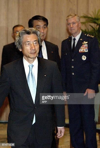 Japanese Prime Minister Junichiro Koizumi left greeting participants of Pacific Rim nations chiefs of staff meeting at the prime minister's official...