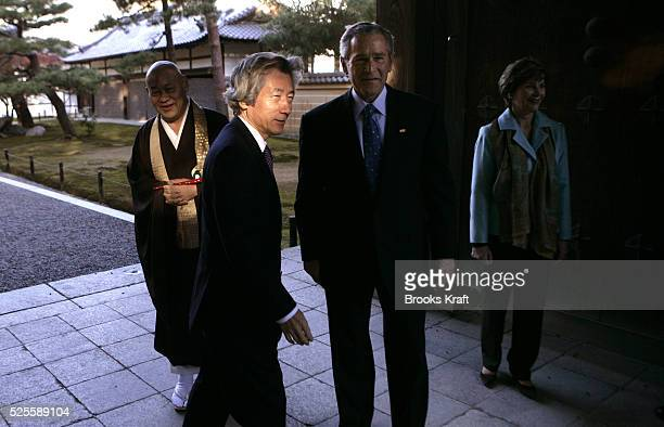 Japanese Prime Minister Junichiro Koizumi second left greets US President George W Bush center and first lady Laura Bush right as Head Monk Reitei...