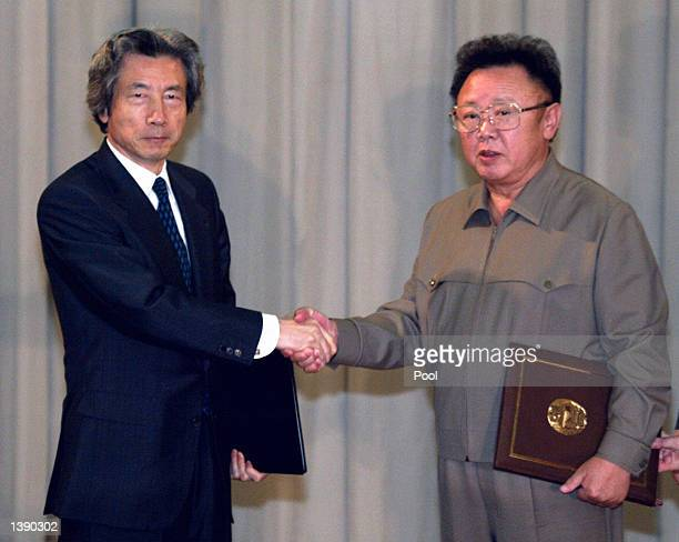 Japanese Prime Minister Junichiro Koizumi shakes hands with North Korean leader Kim Jongil after their summit talks at the Paekhwawon state...