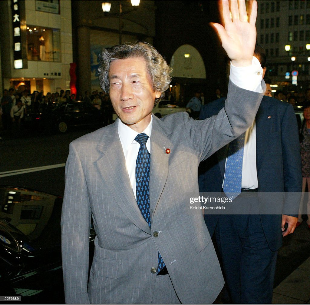 Japanese Prime Minister Junichiro Koizumi walks to his car after dining at a restaurant on June 12, 2003 in Tokyo, Japan. With the resistance from his own party, LPD, Koizumi is having a hard time at the Diet to modify the law to send the self defence force to Iraq.