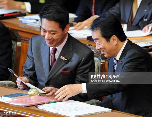Japanese Prime Minister Naoto Kan and Foreign Minister Seiji Maehara share a light moment in the lower house of the parliament prior to delivering...